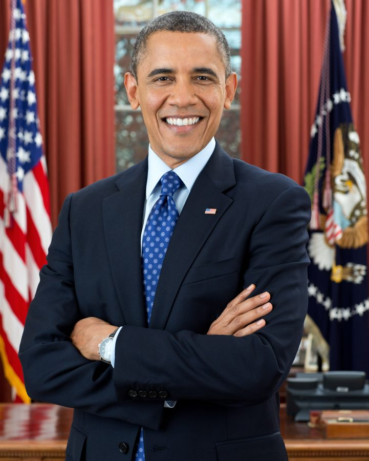 President Barack Obama, the first Black and Biracial President of the United States, smiling for the camera.