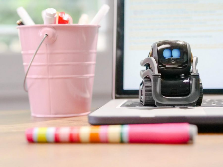 Robot in front of computer screen